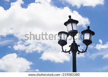 Old Fashioned Street Lamp Close Up View before Blue Sky - stock photo