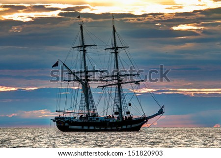 Old fashioned tall ship at sunset