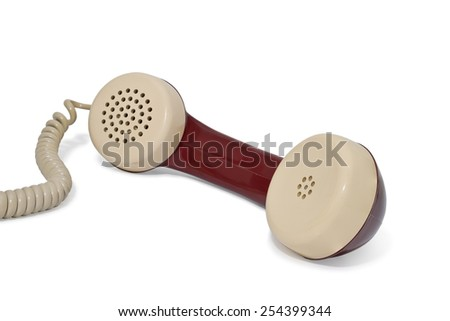 old fashioned telephone receiver and cord, isolated on white - stock photo