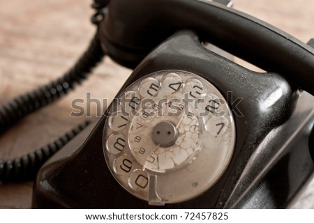 Old fashioned telephone with receiver on the hook. - stock photo