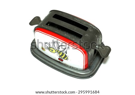 Old Fashioned Toaster toy with bee cartoon - stock photo