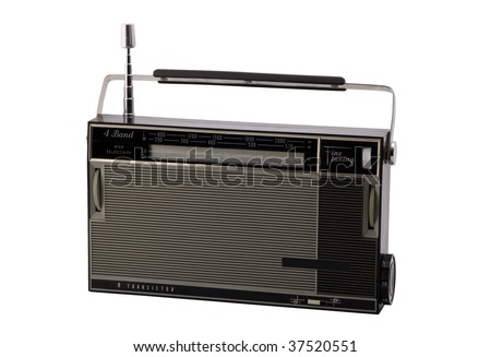 Old-fashioned transistor radio receiver, isolated on white background.