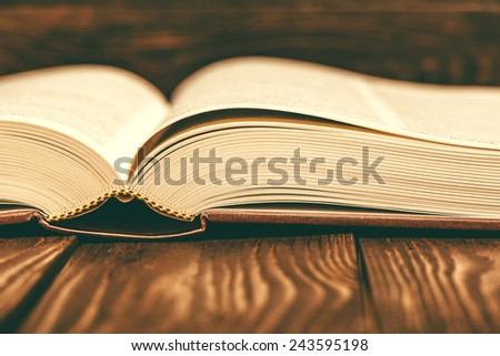 Old fashioned vintage book on wooden background
