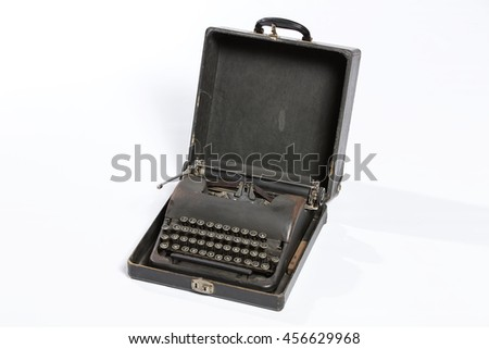 Old fashioned, vintage typewriter isolated on white background with a blank sheet of paper inserted with space for a custom message - stock photo