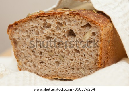Old-fashioned wholegrain bread loaf with pumpkin seeds - stock photo