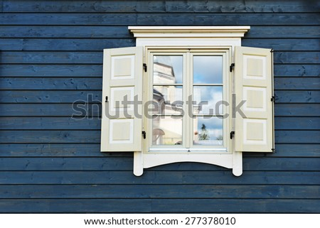 Old fashioned window of wooden house - stock photo