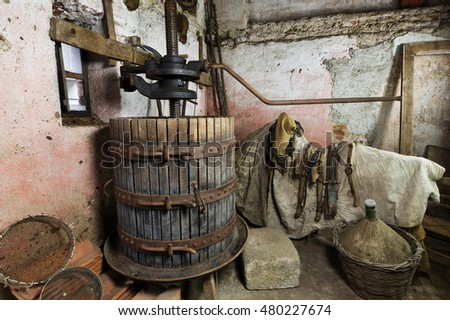Old Fashioned Wine Press machine in rural cellar