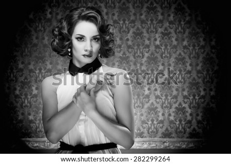 Old-fashioned woman vintage toning on retro blue background. Professional make up and hairstyle. Studio lighting - stock photo