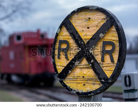 Old fashioned wooden RR Railroad warning sign with red caboose in background in Warrenton, Virginia - stock photo