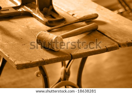 Old-fashioned worktable background tinted in sepia - stock photo