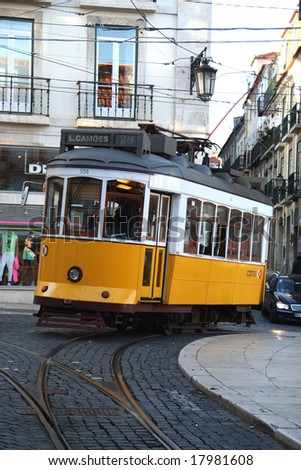Old fashioned yellow tram in Lisbon, Portugal - stock photo