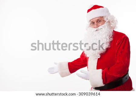 Old Father Christmas is inviting everyone to celebrate New Year with him. He is gesturing and smiling. The man is looking at the camera with anticipation. Isolated and copy space in left side - stock photo