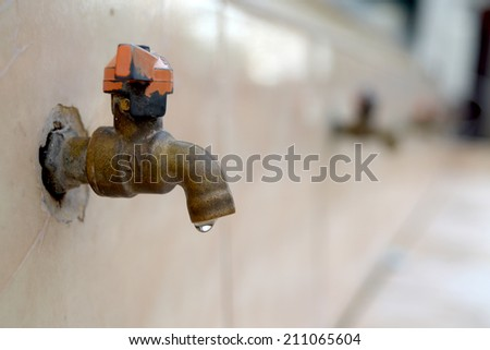 old Faucet in school - stock photo
