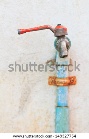 Old faucet water tap on wall  - stock photo