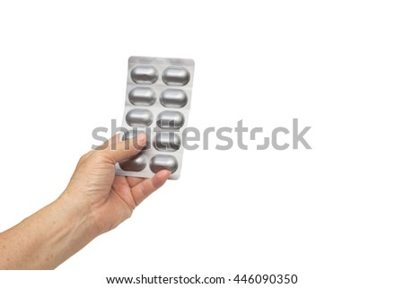Old female hand holding a drug package - Drug and medicine usage for the elderly concept - stock photo