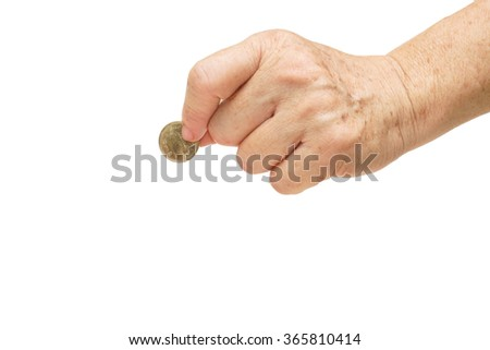 old female hand holding a golden coin