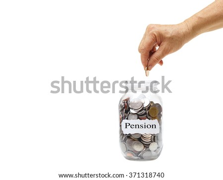 old female hand putting a golden coin into a bottle full of coins with word saying pension - stock photo