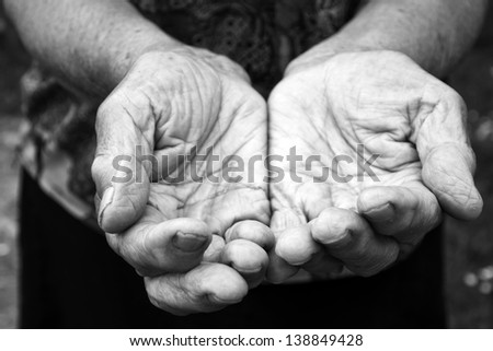 Old female hands in black and white - stock photo
