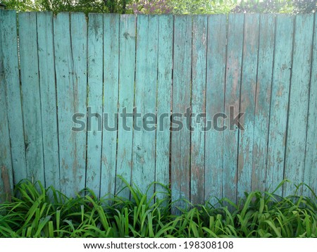 Old fence in village / outdoors photography of wooden fence  - stock photo