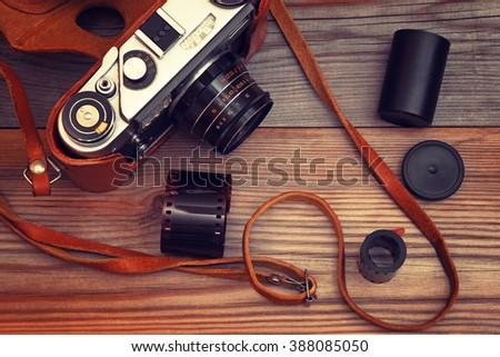 Old film camera. Vintage style.Retro toning. - stock photo