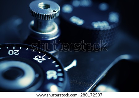 Old film DSLR camera. The wheel of choice shutter and shutter button. Close up view. Macro. Selective focus. Vintage photo. Toning.