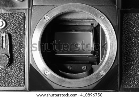 Old film DSLR camera without lens. Metal threaded mount and mirror. Close up view. Macro. Vintage photo toning. - stock photo