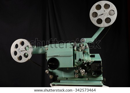 Old film projector on a white background - stock photo