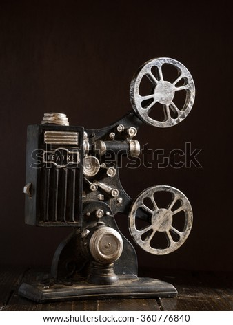 Old film projector over a dark background - stock photo