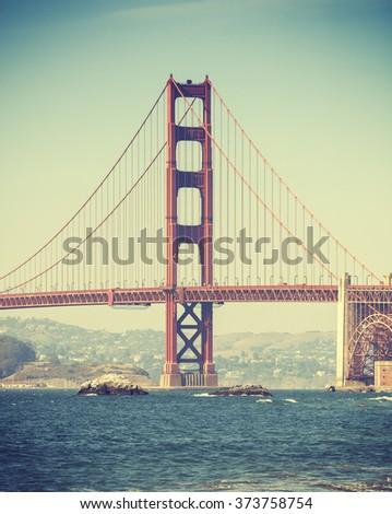 Old film retro style Golden Gate Bridge in San Francisco, USA. - stock photo
