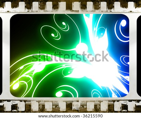 old film strip with an abstract butterfly in it