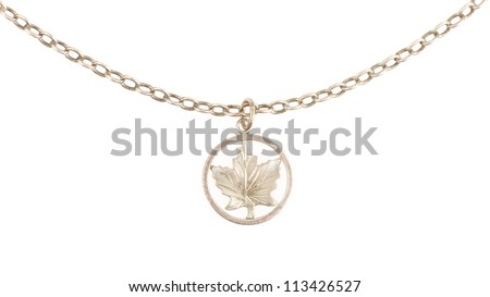 Old filthy silver hanger on a silver chain (maple leaf), isolated on white