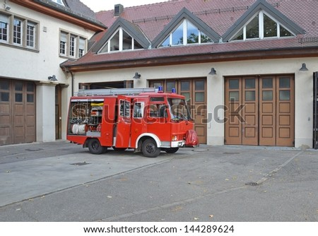 old fire truck parked in front of the Fire Hall garages in Lahr, Germany - stock photo