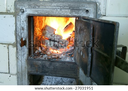Old fireplace and door, stove, fire