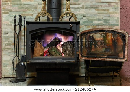 Old fireplace with a burning firewoods
