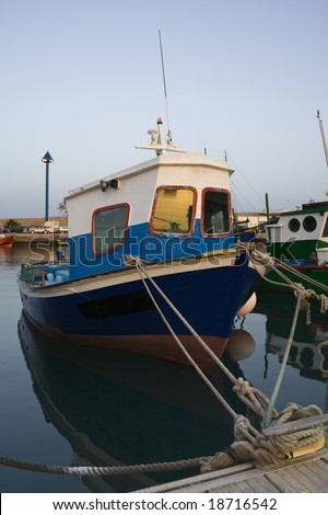 old fisher boat at harbor of Moro Jable, Fuerteventura, in the evening