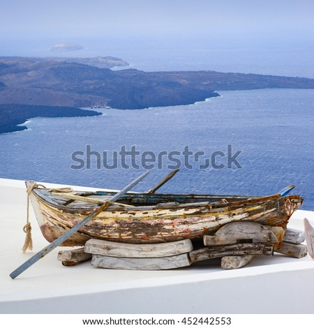 old fisher boat with the caldera view in santorini greece