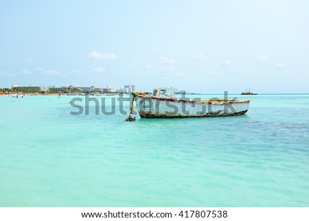 Old fisher's boat at Palm Beach in Aruba in the Carribean - stock photo