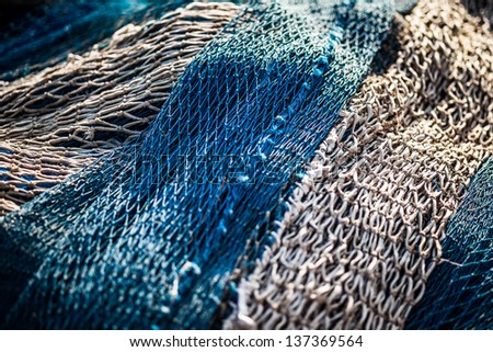 Old fisher's net with nice light. - stock photo
