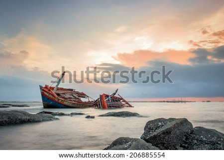 Old Fisherman boat at sunset
