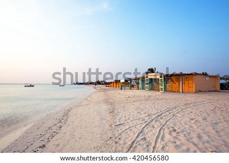 Old fisherman huts on Aruba island in the Caribbean sea - stock photo