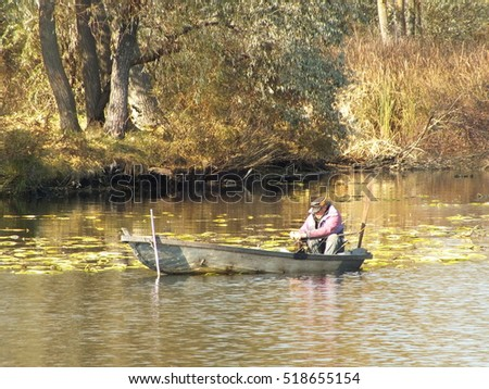 Old fisherman on wooden boat