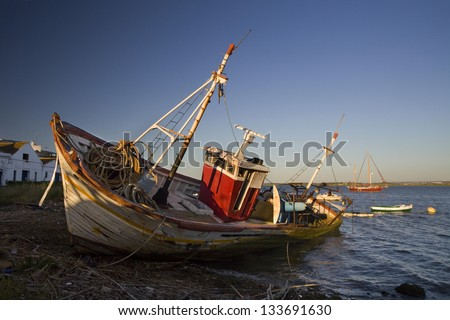 Old fishing boat. Abandoned wooden fishing boat in Ayamonte, Huelva, Spain, Europe - stock photo