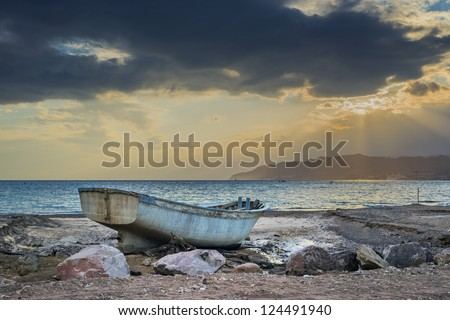 Old fishing boat after storm at the gulf of Aqaba, Eilat, Israel - stock photo