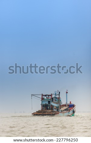 Old fishing boat floating in the sea