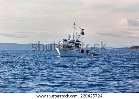 Old fishing boat in the Adriatic sea. Horizontal shot - stock photo