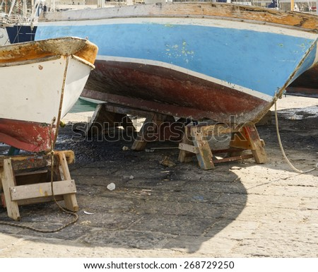 old fishing boat in the harbour of la spezia - stock photo