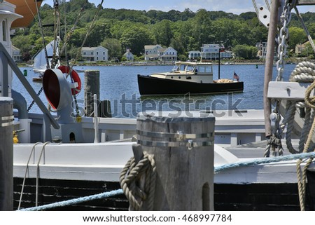 Old fishing boat on beautiful harbor overlooking ships and boat riggings.