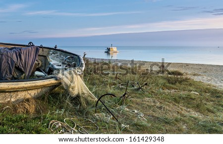 Old fishing boat on the Baltic Sea at dawn, Latvia, Europe - stock photo