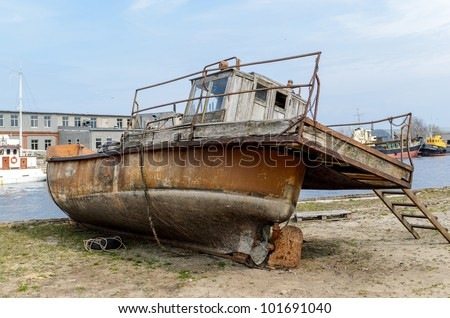 Old fishing boat on the coast of Baltic