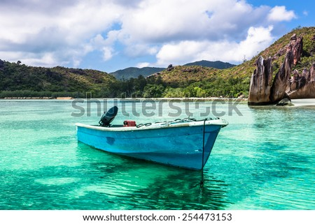 Old fishing boat on Tropical beach at Curieuse island Seychelles. Horizontal shot